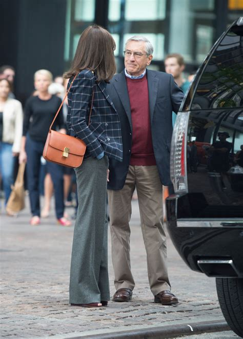 Anne Hathaway Carries Céline on the Set of New Movie